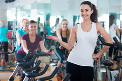Girl and other females working out in sport club Stock Image