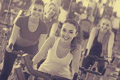 Girl and other females working out in sport club Royalty Free Stock Photo