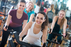 Girl and other females working out in sport club Stock Photo