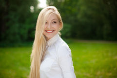 Girl out in the park with long blonde hair Royalty Free Stock Images