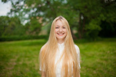 Girl out in the park with long blonde hair Stock Photography