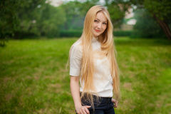 Girl out in the park with long blonde hair Royalty Free Stock Image