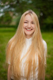 Girl out in the park with long blonde hair Stock Photos