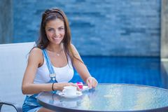 Girl in outdoor cafe stock images