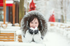 Girl in an outdoor cafe on a winter day Royalty Free Stock Photo