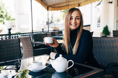 Girl in outdoor cafe Stock Image