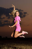 Girl outdoor jumping Royalty Free Stock Photos