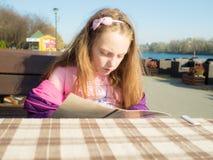 Girl in outdoor restaurant Royalty Free Stock Photos