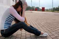 Girl outdoor road sad alone Royalty Free Stock Images