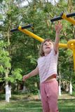 Girl on outdoor sport ground / gym Stock Image