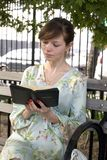 Girl outdoors with Bible Stock Photos