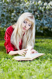 Girl outdoors with book Royalty Free Stock Photos