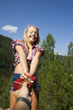 Girl outdoors celebrating birthday is happy and Royalty Free Stock Images