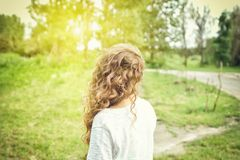 Girl outdoors with curly hair Royalty Free Stock Photo