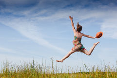 Girl Outdoors enjoying nature. Fun jump ) Royalty Free Stock Photo