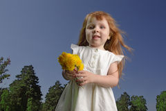 Girl outdoors with flower Royalty Free Stock Image