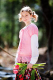 Girl outdoors holding tulips Royalty Free Stock Photography