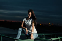 Girl outdoors at night Stock Photo