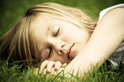 Girl outdoors sleeping Royalty Free Stock Images