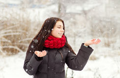 Girl outdoors in snowy winter day Stock Photo