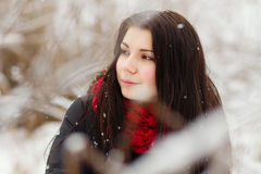 Girl outdoors in snowy winter day Royalty Free Stock Photos