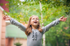 Girl outdoors in sunny summer day Royalty Free Stock Images