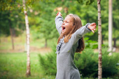 Girl outdoors in sunny summer day Royalty Free Stock Photo