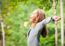 Girl outdoors in sunny summer day Stock Image