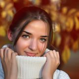 Girl outdoors in sweater Royalty Free Stock Photography
