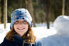 Girl outdoors wearing a winter hat. Twelve year old girl wearing a winter hat outdoors in the snow Stock Photos