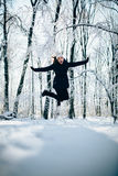 Girl outdors in the forest and jump Royalty Free Stock Photo