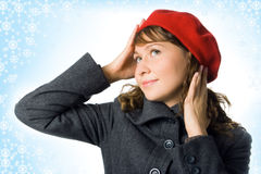 Girl in outer clothing  beret. And snowflake Royalty Free Stock Photography