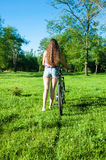 Girl outgoing with her bicycle Royalty Free Stock Photo