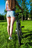 Girl outgoing with her bicycle Stock Photos