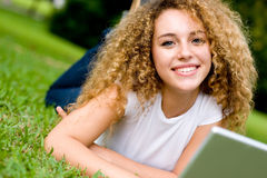Girl Outside. A pretty teenage girl outside with a laptop stock photos