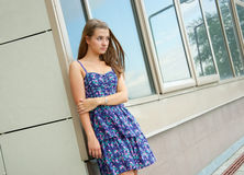 Girl outside the building Stock Photography