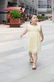 Girl outside the emporium Royalty Free Stock Photos