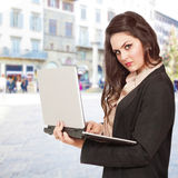 Girl outside on laptop Royalty Free Stock Images