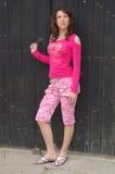 Girl outside an old door stock photos