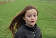 Girl outside in stormy weather Stock Images