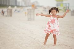 Girl outstretching her arms Stock Images