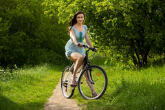 Girl over a bicycle Royalty Free Stock Photos