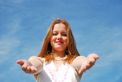 Girl over blue sky Stock Image