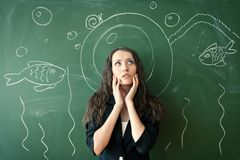 Girl over chalkboard with funny picture Stock Photos