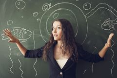 Girl over chalkboard  like a diver Royalty Free Stock Photos