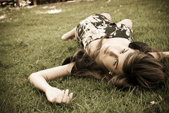 Girl over grass. Young girl over the grass, vintage toned Royalty Free Stock Photos