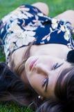 Girl over grass Stock Photos