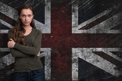 Girl over Grungy UK Flag background Stock Image