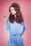 Girl Over Pink Sixties Style Royalty Free Stock Photography