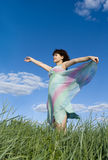 Girl over sky background Royalty Free Stock Photos